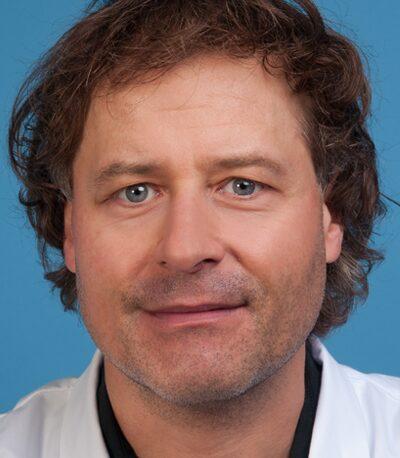 Dr. Mike Brügger